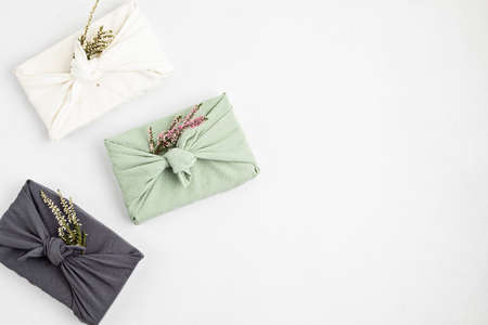 Zero waste gift wrapping traditional Japanese furoshiki style. Plastic free hand made gift package for Christmas, birthday, Easter and other occasions Stock fotó