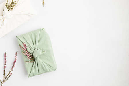 Zero waste gift wrapping traditional Japanese furoshiki style. Plastic free hand made gift package for Christmas, birthday, Easter and other occasions