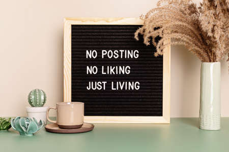 No posting, no liking, just living motivational quote on the letter board. Inspiration text for digital detox