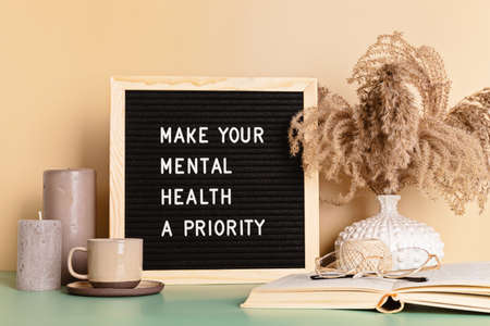 Make your mental health a priority motivational quote on the letter board. Inspiration psycological text Stock Photo