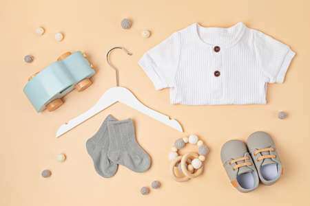 Gender neutral baby garment, toys and accessories. Organic cotton clothes for newborn Archivio Fotografico