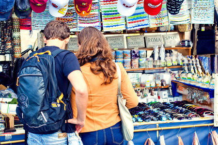 whilst: Couple shop for souvenirs whilst on holiday Rome Editorial