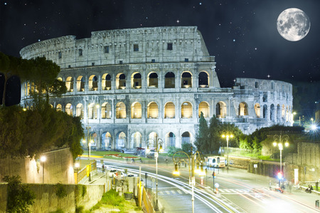 Colosseum at night, Rome, Italy with huge Moon photo