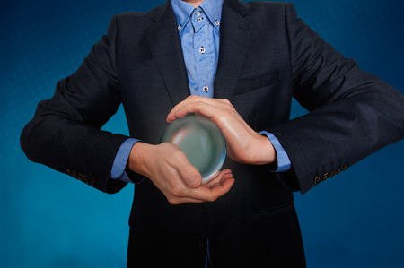 scrying: Businessman predict the future. business fortune telling. Stock Photo