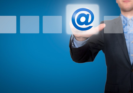 Businessman Touching Email Button and Ticking Check Box photo