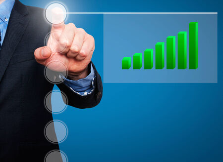 Businessman in dark suit pushing button, visual screen Growth graph going up. Blue background