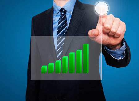 going up: Businessman in dark suit pushing button, visual screen Growth graph going up. Blue background