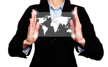 Businesswoman in dark suit is holding world map global communication.Office background