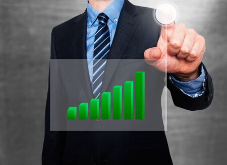 going up: Businessman in dark suit pushing button, visual screen Growth graph going up. Grey background Stock Photo