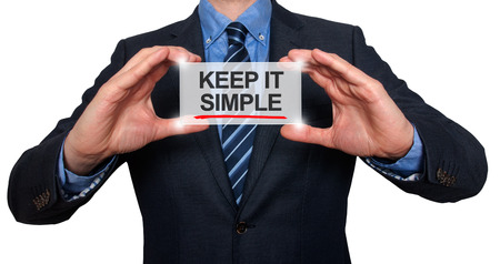 Keep It Simple in a navigation bar on a virtual screen with a businessman holding it. White background