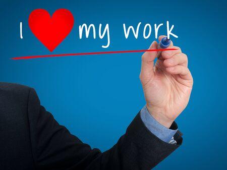 heart work: Businessman writing I love my work with heart shape. Blue background Stock Photo