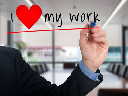 heart work: Businessman writing I love my work with heart shape. Office background Stock Photo