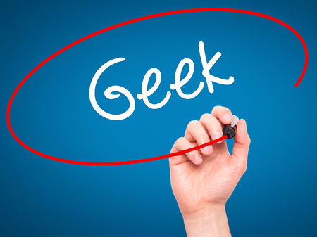 html5: Man Hand writing Geek with black marker on visual screen. Isolated on blue. Business, technology, internet concept. Stock Photo