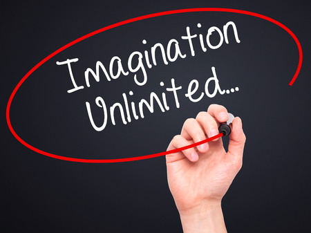 unlimited: Man Hand writing Imagination Unlimited... with black marker on visual screen. Isolated on black. Business, technology, internet concept. Stock Photo