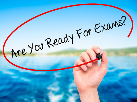 test deadline: Man Hand writing Are You Ready For Exams? with black marker on visual screen. Isolated on nature. Business, technology, internet concept. Stock Photo