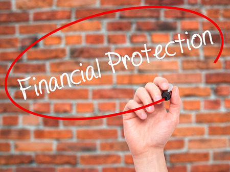 secret society: Man Hand writing Financial Protection with black marker on visual screen. Isolated on bricks. Business, technology, internet concept. Stock Photo