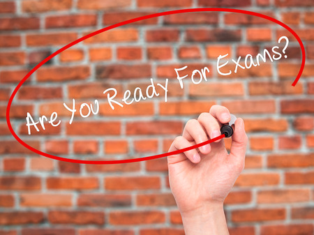 unforeseen: Man Hand writing Are You Ready For Exams? with black marker on visual screen. Isolated on bricks. Business, technology, internet concept. Stock Photo