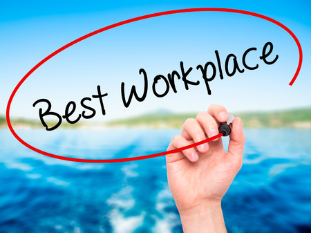 fulfilled: Man Hand writing Best Workplace with black marker on visual screen. Isolated on nature. Business, technology, internet concept. Stock Photo Stock Photo