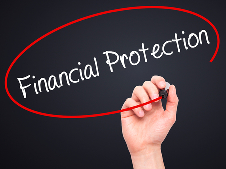 financial protection: Man Hand writing Financial Protection with black marker on visual screen. Isolated on black. Business, technology, internet concept. Stock Photo