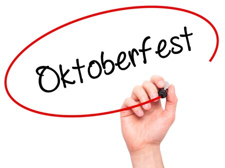 bier festival: Man Hand writing Oktoberfest with black marker on visual screen. Isolated on white. Business, technology, internet concept. Stock Photo