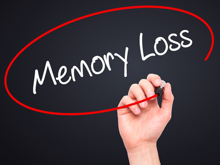 degenerative: Man Hand writing Memory Loss with black marker on visual screen. Isolated on black. Business, technology, internet concept. Stock Photo Stock Photo