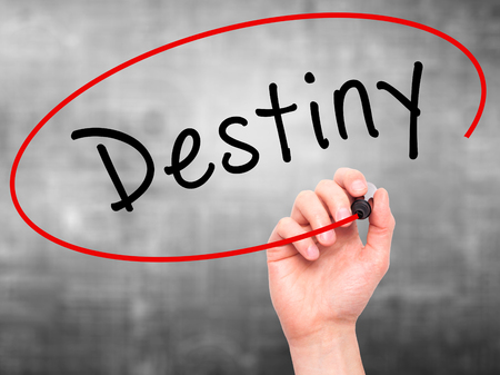 Man Hand writing Destiny black marker on visual screen. Isolated on grey. Business, technology, internet concept. Stock Image