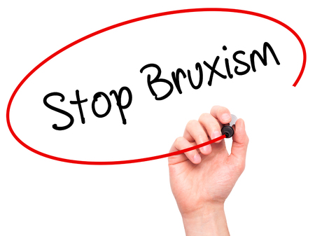 Man Hand writing Stop Bruxism with black marker on visual screen. Isolated on white. Business, technology, internet concept. Stock Photo Standard-Bild