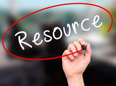 resourcefulness: Man Hand writing Resource with black marker on visual screen. Isolated on office. Business, technology, internet concept. Stock Image