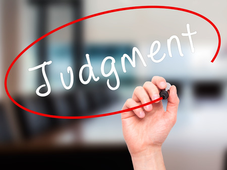 judgment: Man Hand writing Judgment with black marker on visual screen. Isolated on office. Business, technology, internet concept. Stock Image Stock Photo