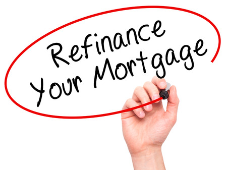 lender: Man Hand writing Refinance Your Mortgage with black marker on visual screen. Isolated on white. Business, technology, internet concept. Stock Image Stock Photo