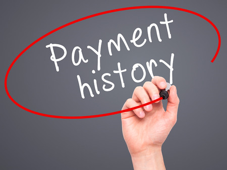 bank records: Man Hand writing Payment history with black marker on visual screen. Isolated on grey. Business, technology, internet concept. Stock Image Stock Photo