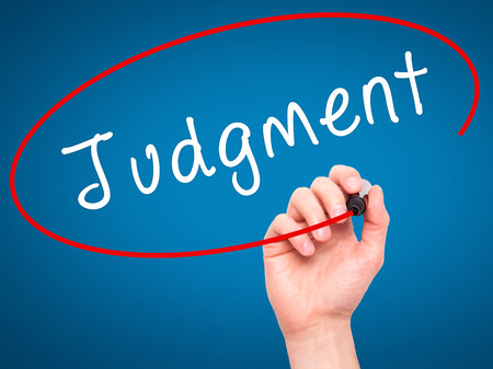 definition define: Man Hand writing Judgment with black marker on visual screen. Isolated on blue. Business, technology, internet concept. Stock Image Stock Photo