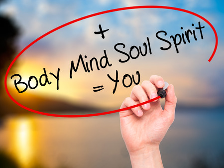 mind body soul: Man Hand writing Body + Mind + Soul + Spirit = You with black marker on visual screen. Isolated on nature. Life, technology, internet concept. Stock Image Stock Photo