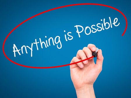 anything: Man Hand writing Anything is Possible with black marker on visual screen. Isolated on blue. Business, technology, internet concept. Stock Photo Stock Photo