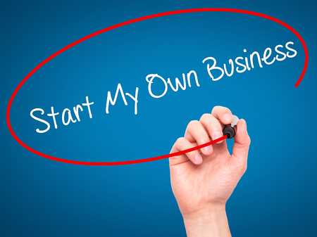 self starter: Man Hand writing Start My Own Business with black marker on visual screen. Isolated on blue. Business, technology, internet concept. Stock Photo