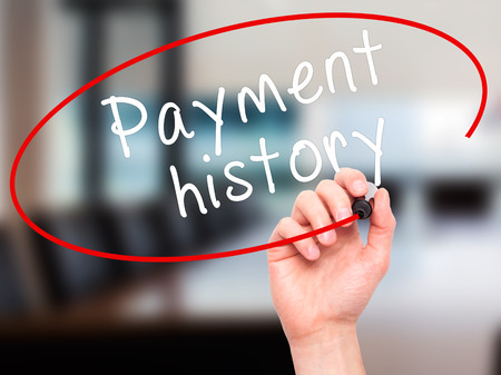 customer records: Man Hand writing Payment history with black marker on visual screen. Isolated on office. Business, technology, internet concept. Stock Image