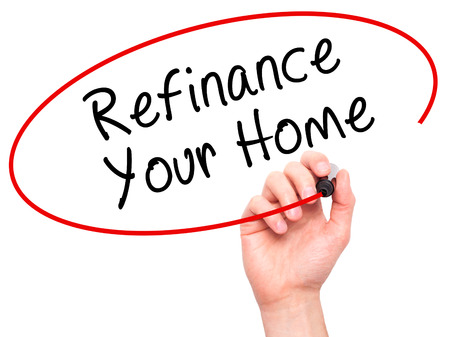 loaning: Man Hand writing Refinance Your Home with black marker on visual screen. Isolated on white. Business, technology, internet concept. Stock Image