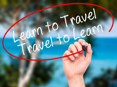 positiveness: Man Hand writing Learn to Travel. Travel to Learn with black marker on visual screen. Isolated on nature. Travel, technology, internet concept. Stock Image Stock Photo