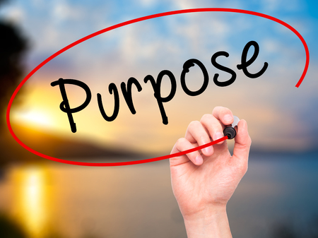 intend: Man Hand writing Purpose with black marker on visual screen. Isolated on nature. Business, technology, internet concept. Stock Image