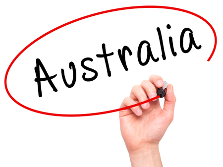 gold coast: Man Hand writing Australia with black marker on visual screen. Isolated on white. Business, technology, internet concept. Stock Image Stock Photo