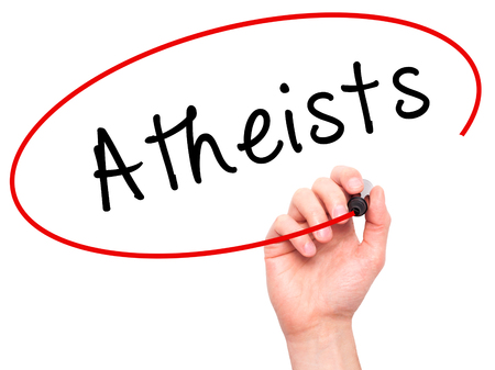 atheism: Man Hand writing Atheists with black marker on visual screen. Isolated on white. Business, technology, internet concept. Stock Image