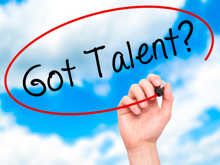 talent management: Man Hand writing Got Talent? with black marker on visual screen. Isolated on sky. Business, technology, internet concept. Stock Image Stock Photo