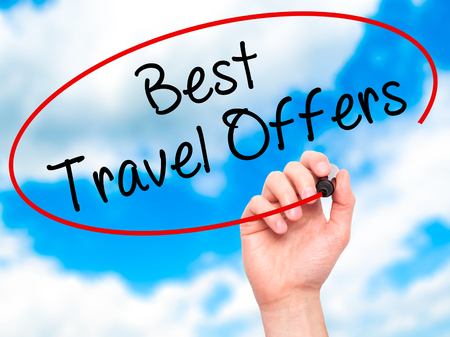 brazilian caribbean: Man Hand writing Best Travel Offers  with black marker on visual screen. Isolated on sky. Travel technology, internet concept. Stock Image