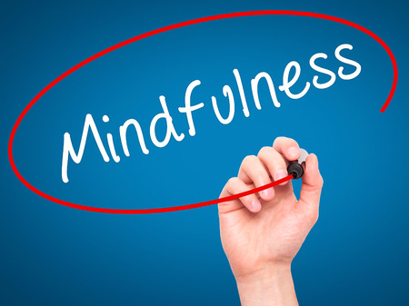 open minded: Man Hand writing Mindfulness  with black marker on visual screen. Isolated on blue. Business, technology, internet concept. Stock Image Stock Photo