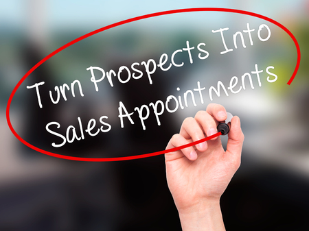 appointments: Man Hand writing Turn Prospects Into Sales Appointments  with black marker on visual screen. Isolated on office. Business, technology, internet concept. Stock Image Stock Photo