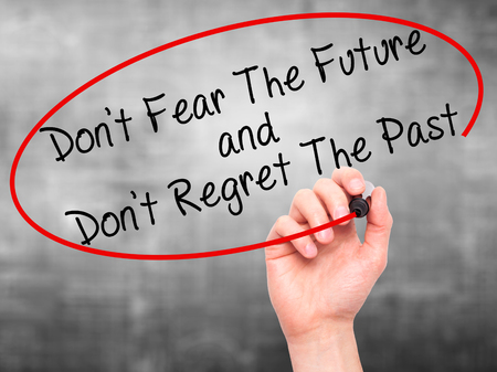 regret: Man Hand writing Dont Fear The Future and Dont Regret The Past with black marker on visual screen. Isolated on grey. Life, technology, internet concept. Stock Image Stock Photo