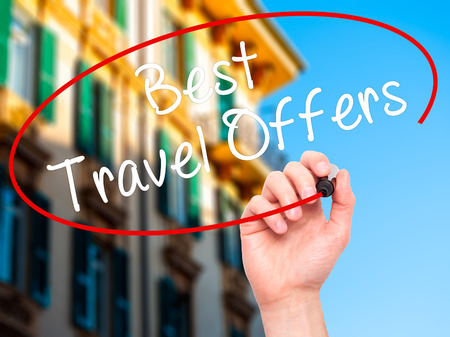 accomodation: Man Hand writing Best Travel Offers  with black marker on visual screen. Isolated on city. Travel technology, internet concept. Stock Image Stock Photo