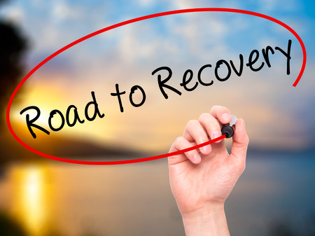 road to recovery: Man Hand writing Road to Recovery with black marker on visual screen. Isolated on nature. Business, technology, internet concept. Stock Image Stock Photo