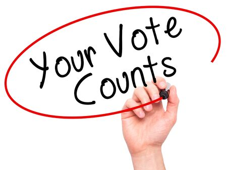 libertarian: Man Hand writing Your Vote Counts with black marker on visual screen. Isolated on white. Business, technology, internet concept. Stock Image