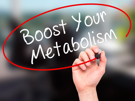 Man Hand writing Boost Your Metabolism with black marker on visual screen. Isolated on office. Business, technology, internet concept. Stock Image